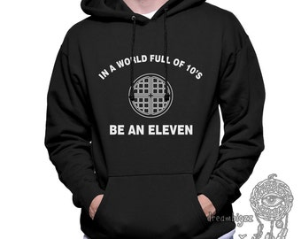 In a world full of 10's be an ELEVEN printed on Unisex Hoodie