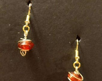 Red and gold circle with gold fishhooks