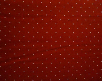 Americana: Tiny White Stars (red background); sold by the yard