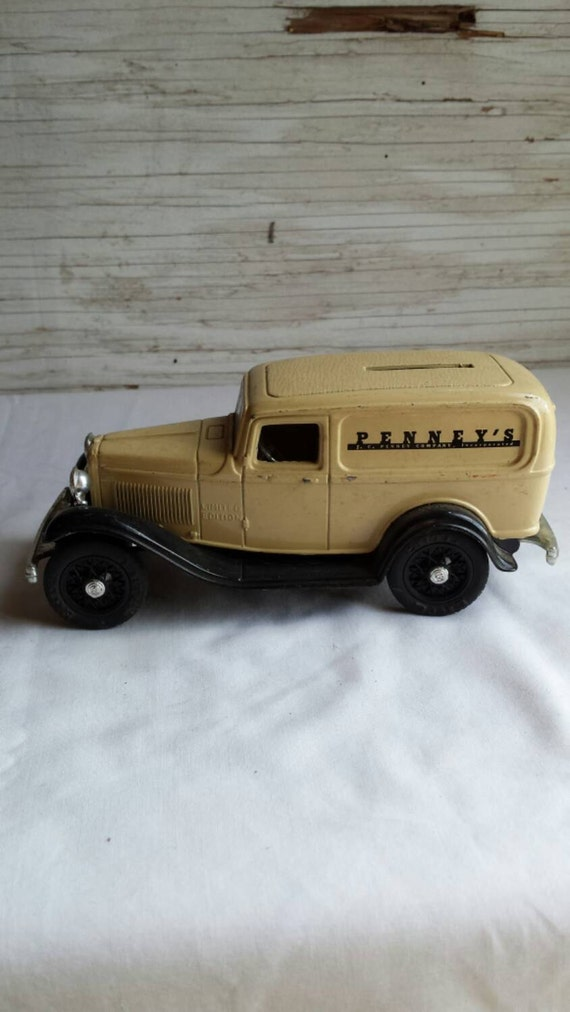 Vintage 1992 Ertl Die Cast Coin Bank. Bank is a 1932 Ford Delivery Van Adv. for J C Penney Co Inc. This Coin bank has the key.  No box