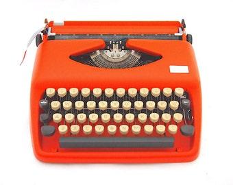 Triumph Tippa typewriter, orange typewriter, custom made typewriter, vintage typewriter, working typewriter, portable typewriter, qwerty.