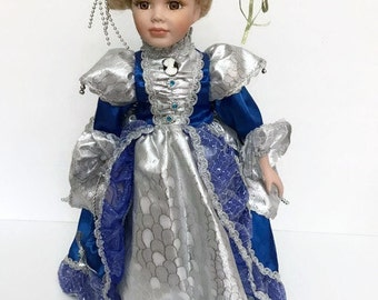 Vintage Porcelain Doll Wearing a victorian Dress Blue and Silver