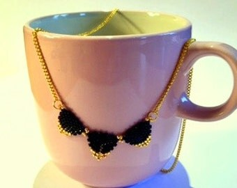 """Elegant Triangle """"Bunting"""" Necklace in Black and Gold Beads"""
