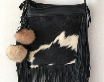 New cow fur & leather hand made bag , medium size .
