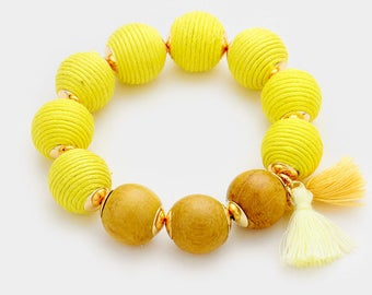 Wooden ball thread-wrapped bracelet with tassel