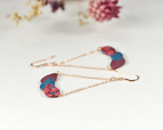 Rose gold filled pendant earrings with burgundy and blue patterned leaves
