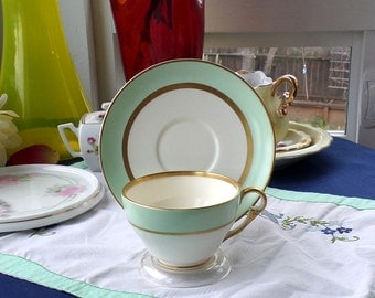 "Vintage Pope Gosser ""Spring"" china coffee or teacup and saucer . Soft spring green and light cream with coin gold on rims, handle."