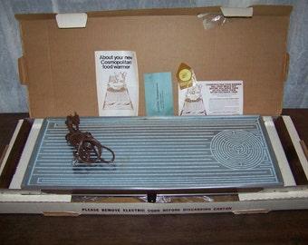 How does a Salton food warmer work?