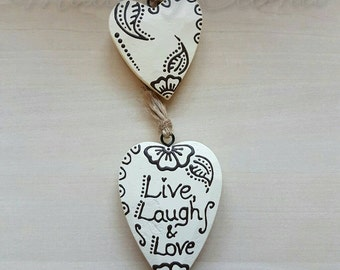 "Handpainted pair of hanging wooden hearts. With henna style design. Cream with brown design. ""Live laugh love"" quote. Natural twine to hang."