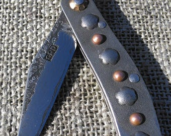 Steel handle friction folding knife