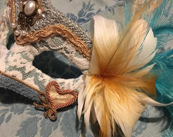 Venetian mask color blue and nude pink.