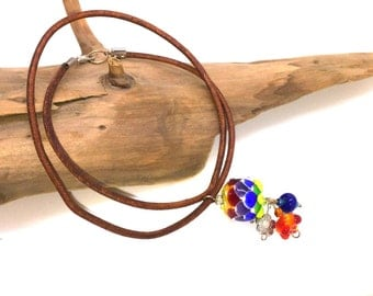 Necklace with leather strap and flower glass bead