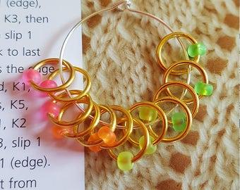 12 medium sized snag free ring style knitting stitch markers  . Fluorescent gold