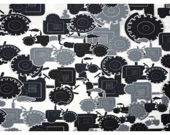 Black and grey Tractors on white cotton jersey, one unit is 0.5 metre