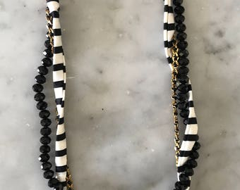 Striped fabric necklace, glass beads and golden chain with leather inserts