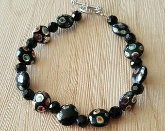 Womens bracelet with decorative flat round black shimmery beads