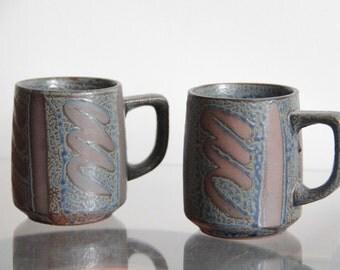 Vintage ceramic mugs with blue patterned glaze