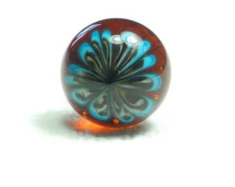 Pins, mini-broche, cabochon glass spun with a blowtorch, turquoise, ivory and black Chrysanthemum on a background of amber