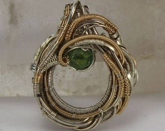 Wire wrapped pendant in sterling silver and gold fill with demantoid garnet