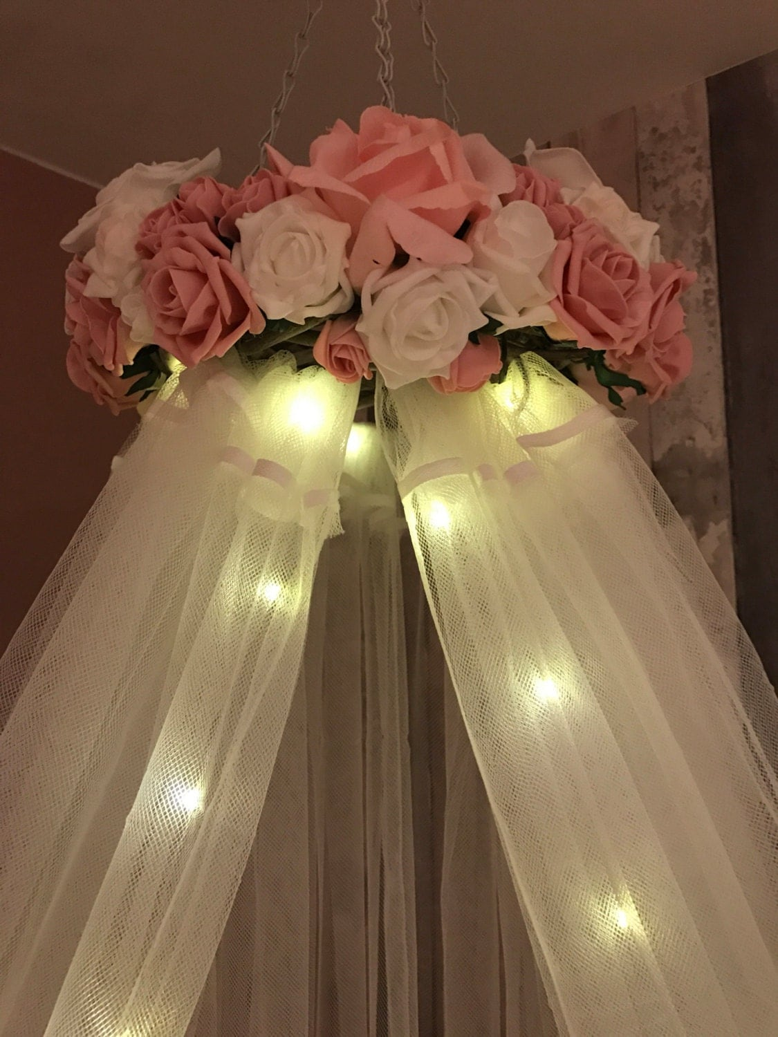 Soft Pink And White Crib Canopy With Fairy Lights And Flowers