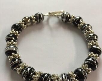 Silver/Black Beaded Bracelet.