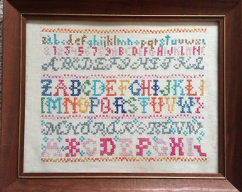 Alphabet sampler cross stitch framed and ready to hang