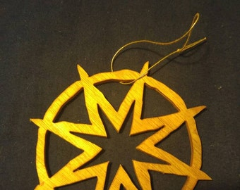 Hand made scroll sawn wooden Christmas ornament with star in circle