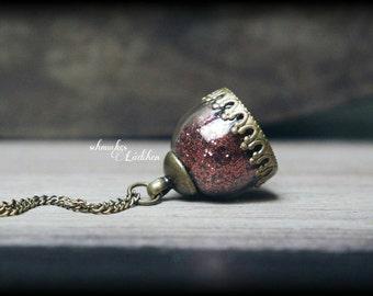 Antique bronze glass dome chain with copper glitter dust