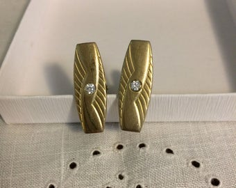 Vintage gold-tone men's cuff links with faux diamond center