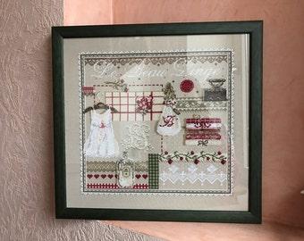 A cross stitch picture . Sampler.