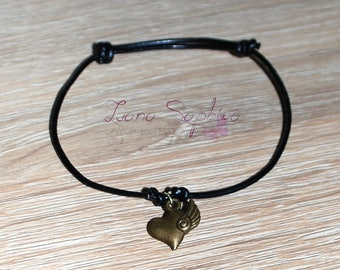 Black leather bracelet with heart