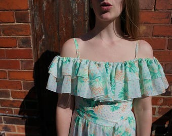 1970s Cotton Chiffon Maxi Dress with an off the Shoulder Ruffle Neckline in a Green and Orange Flower Print