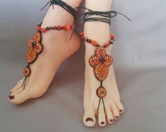 A Pair of Ornate Orange, Coral and Pink Beaded Barefoot Sandals