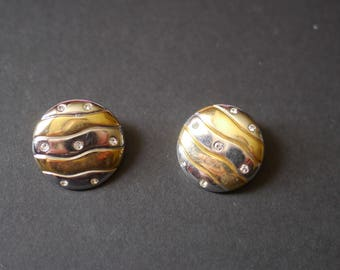 Gold tone and silver tone striped metal earrings with rhinestone, clip ons