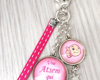 Keychain bag charm has message a pre-school which ensures pink candy. REF.116