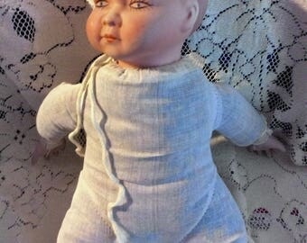 Vintage Ceramic and plumped linen doll