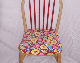 A contemporary hand painted solid wooden chair