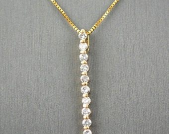 14 karat yellow gold diamond drop  necklace with single share prong