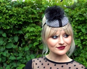 Briony - tweed/check button hat with black organza flower and veling