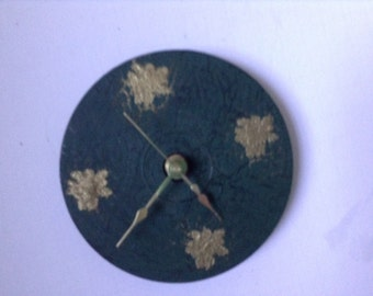 CD battery clock green with gold embossed pine cones