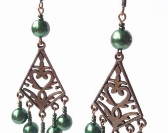 Charming elegant chandelier earrings with dark brown metal details