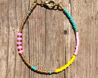 thin & tender hippie bracelet with neon pink beads, pink, turquoise, yellow, gold