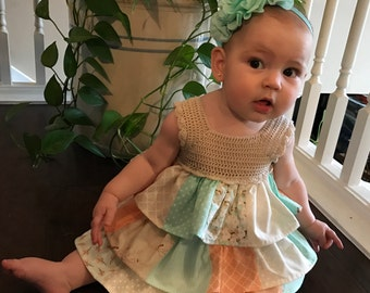 Peach and teal 3 tiered baby dress with beige crotchet top, size 6-9 mos.