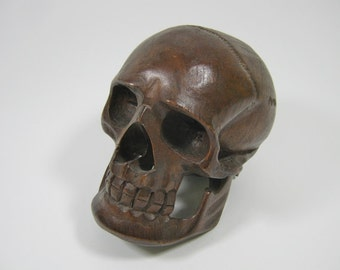 ONE (1) Wooden Skull