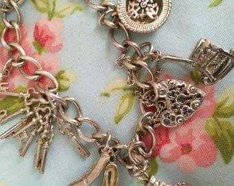 Reserved for Michelle - Beautiful vintage 925 sterling silver charm bracelet with rare nuvo charms - hallmarked