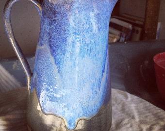 Beautiful tall blue glazed jug