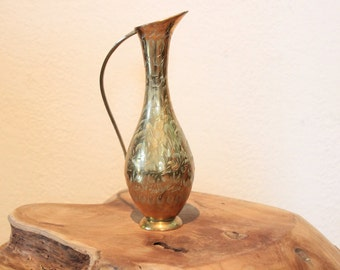 Engraved brass vase