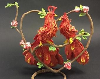 Birds of Paradise,a Phoenix figurine,a statuette of the Firebird