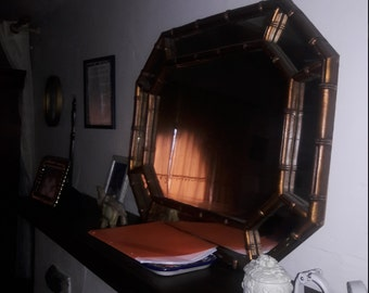 Beautiful wood framed mirror.  Looks nice on the mantle but can also be hung in the wall. Well made and maintained.