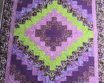 "Purple Strip Pieced Wall Hanging Quilt, measures 39"" x 49"""